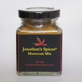 A square shaped glass jar with a black, red and yellow label containing Jonathan's Spices moroccan mix